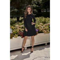 Sukienka z falbankami l271. Czarne sukienki hiszpanki Lemoniade, l, z falbankami, z długim rękawem. W wyprzedaży za 129,00 zł.