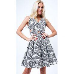 Sukienki hiszpanki: Sukienka rozkloszowana we wzory czarno-kremowa G5011