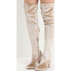 Beżowe Kozaki Sincere. Brązowe buty zimowe damskie marki Born2be, z okrągłym noskiem, na wysokim obcasie, na słupku. Za 99,99 zł.