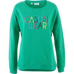 Bluza z nadrukiem bonprix szmaragdowy z nadrukiem. Zielone bluzy z nadrukiem damskie marki bonprix, z kopertowym dekoltem, kopertowe. Za 27,99 zł.