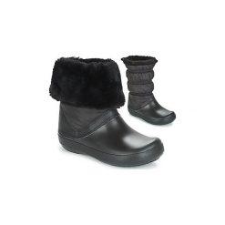 Śniegowce Crocs  CROCBAND WINTER BOOT. Różowe buty zimowe damskie marki Crocs, z materiału. Za 309,00 zł.