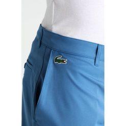 Chinosy męskie: Lacoste Sport Spodnie materiałowe medway
