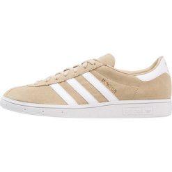 Adidas Originals MUNCHEN Tenisówki i Trampki raw gold/footwear white/gold metallic. Brązowe tenisówki damskie marki adidas Originals, z materiału. Za 449,00 zł.