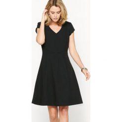 Sukienki hiszpanki: Sukienka rozszerzana, serża ze stretchem