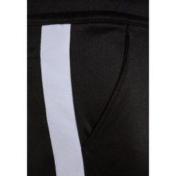 Nike Performance TRIBUTE Spodnie treningowe black/white. Czarne spodnie chłopięce marki Nike Performance, z bawełny. Za 159,00 zł.