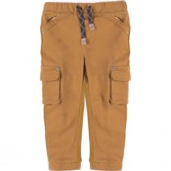 Spodnie. Pomarańczowe spodnie chłopięce SCENT, z bawełny. Za 49,90 zł.