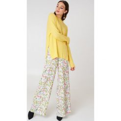 Trendyol Sweter z półgolfem - Yellow. Żółte swetry klasyczne damskie marki Trendyol, z dzianiny, z golfem. W wyprzedaży za 36,98 zł.