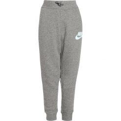 Nike Performance MODERN  Spodnie treningowe carbon heather/cool grey/cool grey/glacier blue. Szare spodnie dresowe dziewczęce Nike Performance, z bawełny. W wyprzedaży za 132,30 zł.