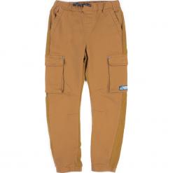 Spodnie. Pomarańczowe chinosy chłopięce NORDIC EXPEDITION, z bawełny. Za 69,90 zł.