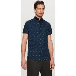Koszula z mikroprintem slim fit - Granatowy. Niebieskie koszule męskie slim marki QUECHUA, m, z elastanu. Za 89,99 zł.
