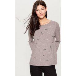 Sweter z aplikacją - Jasny szar. Szare swetry klasyczne damskie marki DOMYOS, z bawełny. Za 99,99 zł.