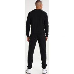 Lacoste Sport HERREN Bluza noir. Czarne bejsbolówki męskie Lacoste Sport, m, z bawełny. Za 369,00 zł.