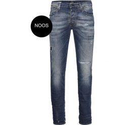 Dżinsy slim. Czarne jeansy męskie slim marki Jack & Jones, l, z bawełny, z klasycznym kołnierzykiem, z długim rękawem. Za 349,86 zł.