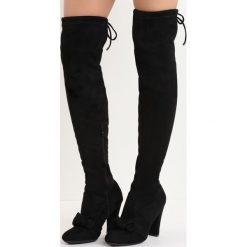 Czarne Kozaki Be Like Minnie. Czarne buty zimowe damskie Born2be, z okrągłym noskiem, na wysokim obcasie, na słupku. Za 99,99 zł.
