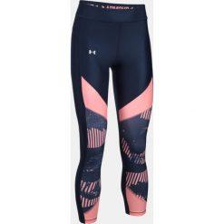 Spodnie sportowe damskie: Under Armour Spodnie damskie HeatGear Colour Blocked Printed Ankle granatowo-różowe  r. XS (1307553-410)