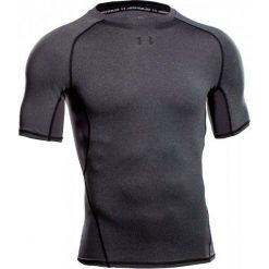 Under Armour Koszulka Sportowa Armour Hg Ss T Carbon Heather Black Xs. Brązowe koszulki do fitnessu męskie Under Armour, m. W wyprzedaży za 89,00 zł.