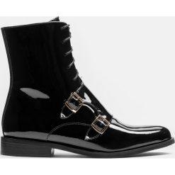 Czarne kozaki krótkie. Czarne buty zimowe damskie marki Kazar, z futra, przed kolano, na wysokim obcasie, na koturnie. Za 649,00 zł.