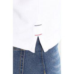 Tommy Jeans MODERN FIT Koszulka polo bright white. Białe t-shirty damskie Tommy Jeans, l, z bawełny. Za 279,00 zł.