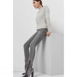 Jeansy skinny z lampasem. Żółte jeansy damskie skinny marki Orsay, s, z bawełny, z golfem. Za 99,99 zł.