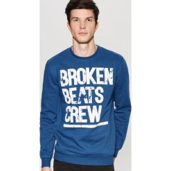 Bluza z nadrukiem - Niebieski. Niebieskie bluzy męskie rozpinane marki House, l, z nadrukiem. W wyprzedaży za 39,99 zł.
