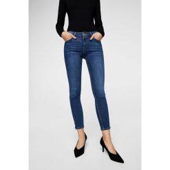 Mango - Jeansy Isa. Niebieskie jeansy damskie rurki Mango, z bawełny. W wyprzedaży za 99,90 zł.