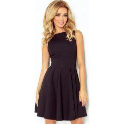125-5 sukienka koło - dekolt łódka - cegiełka - czarna. Czarne sukienki marki numoco, l, z dekoltem w łódkę, oversize. Za 144,00 zł.