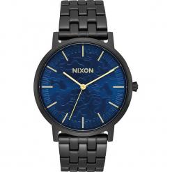 """Zegarek kwarcowy """"Porter"""" w kolorze czarno-niebieskim. Czarne, analogowe zegarki męskie Nixon, ze stali. W wyprzedaży za 227,95 zł."""