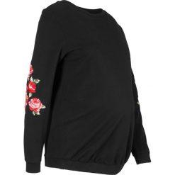Bluza ciążowa z kwiatowym zdobieniem bonprix czarny. Czarne bluzy ciążowe marki bonprix. Za 89,99 zł.