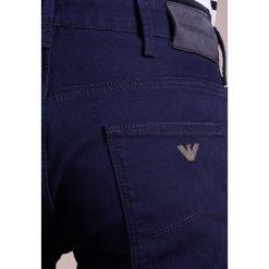 Emporio Armani POCKETS PANT Jeansy Slim Fit blu notte. Niebieskie rurki męskie Emporio Armani. W wyprzedaży za 351,45 zł.