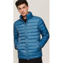 Pikowana kurtka - Niebieski. Czarne kurtki męskie pikowane marki KIPSTA, z poliesteru, do piłki nożnej. Za 119,99 zł.