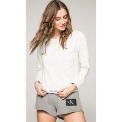Calvin Klein Underwear - Longsleeve piżamowy. Różowe piżamy damskie marki Calvin Klein Underwear, l, z dzianiny. W wyprzedaży za 219,90 zł.