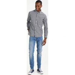 Edwin ED85 DROP CROTCH Jeansy Slim Fit pacific wash. Niebieskie jeansy męskie regular Edwin, z bawełny. Za 419,00 zł.