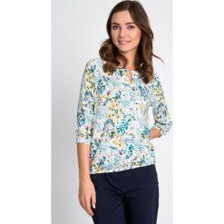 Bluzki asymetryczne: Bluzka bombka w florystyczny print QUIOSQUE