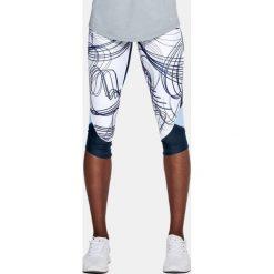 Spodnie sportowe damskie: Under Armour Spodnie damskie ARMOUR FL FAST PRNTD CAPRI granatowo-białe r. S (1320321-409)
