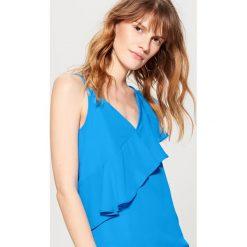 Top z ozdobną falbaną - Niebieski. Niebieskie t-shirty damskie marki Mohito. W wyprzedaży za 49,99 zł.