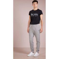 BOSS CASUAL STRIKER Spodnie treningowe light pastel grey. Szare spodnie dresowe męskie BOSS Casual, z bawełny. Za 539,00 zł.