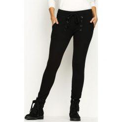 Spodnie dresowe damskie: Czarne Spodnie Dresowe Another Way