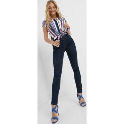 Jeansy skinny. Czarne jeansy damskie skinny marki Orsay, xs, z bawełny, z dekoltem na plecach. Za 99,99 zł.