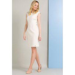 Sukienki balowe: Sukienka z oryginalnym wzorem