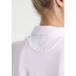 Adidas Golf ULTIMATE365 SHORT SLEEVE Koszulka polo white. Białe topy sportowe damskie adidas Golf, s, z elastanu, z golfem. Za 209,00 zł.
