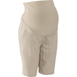 Szorty lniane ciążowe bonprix piaskowy. Niebieskie spodnie ciążowe marki bonprix, z materiału, z dekoltem w serek. Za 99,99 zł.