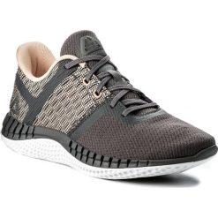 Buty Reebok - Print Run Next CN0428 Grey/Desert Dust/Pnk/Wht. Szare buty do biegania damskie marki Reebok, l, z dzianiny, z okrągłym kołnierzem. W wyprzedaży za 259,00 zł.