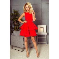 MAGDA Sukienka rozkloszowana - CZERWONA. Czerwone sukienki na komunię marki numoco, na studniówkę, s, z materiału, rozkloszowane. Za 239,99 zł.