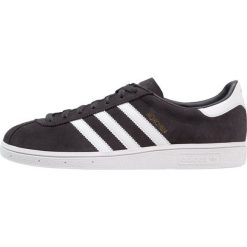 Adidas Originals MÜNCHEN Tenisówki i Trampki carbon/footwear white/gold metallic. Szare tenisówki damskie marki adidas Originals, z materiału. W wyprzedaży za 359,20 zł.