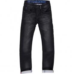 Dżinsy - Slim fit - w kolorze granatowym. Niebieskie spodnie chłopięce marki Retour Denim de Luxe, z aplikacjami, ze skóry. W wyprzedaży za 129,95 zł.