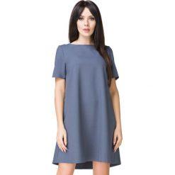 Niebieska Sukienka o Kształcie litery A. Niebieskie sukienki koktajlowe Molly.pl, na co dzień, l, w jednolite wzory, z tkaniny, z dekoltem w łódkę, z krótkim rękawem, mini, oversize. Za 159,00 zł.
