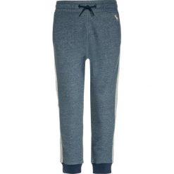 Abercrombie & Fitch SIDE STRIPE  Spodnie treningowe navy. Niebieskie spodnie chłopięce Abercrombie & Fitch, z bawełny. W wyprzedaży za 134,25 zł.