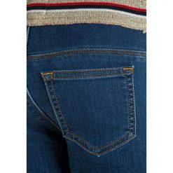 American Outfitters PANTS Jeansy Slim Fit  wash light. Niebieskie spodnie chłopięce marki American Outfitters, z bawełny. W wyprzedaży za 179,40 zł.