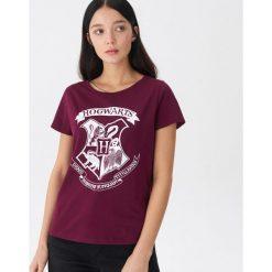 T-shirt Hogwarts - Fioletowy. Fioletowe t-shirty damskie marki DOMYOS, l, z bawełny. Za 29,99 zł.