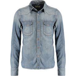Nudie Jeans JONIS Koszula denim. Niebieskie koszule męskie jeansowe Nudie Jeans, m. Za 539,00 zł.